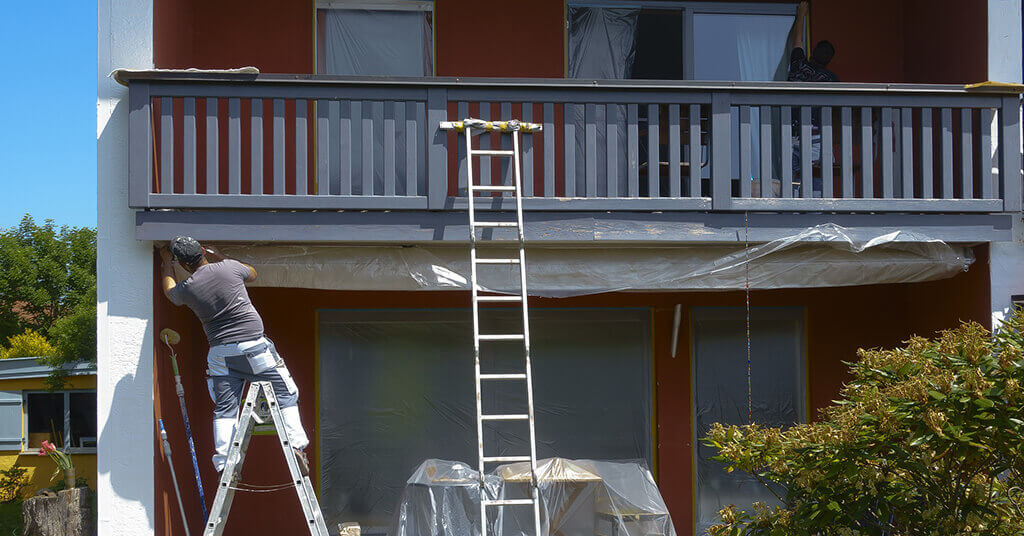 painter working in the front house