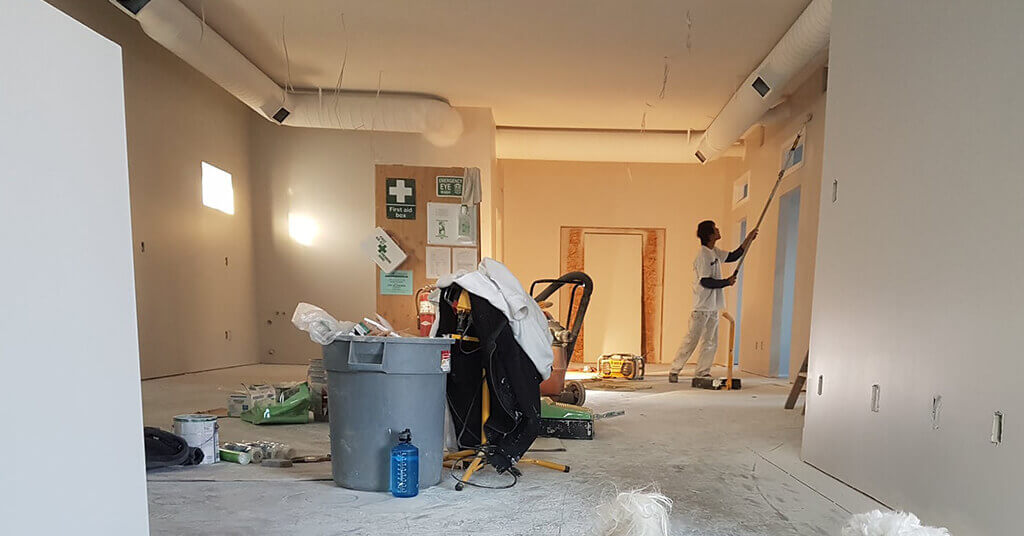 man doing interior painting