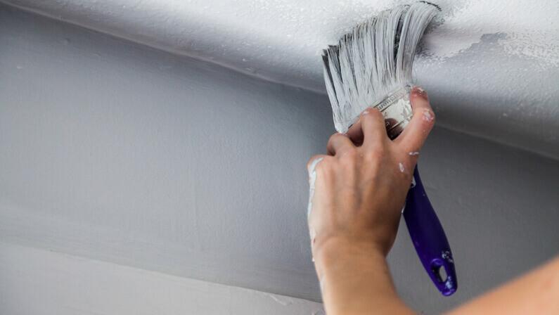 painting cracks ceiling paintbrush